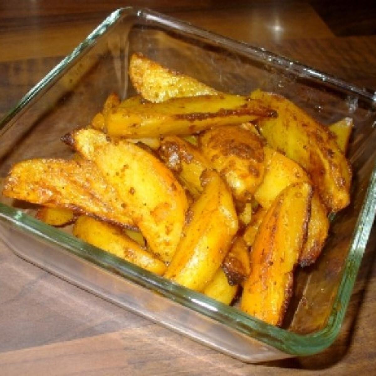Ezen a képen: Fűszeres chilis tepsiben sült burgonya