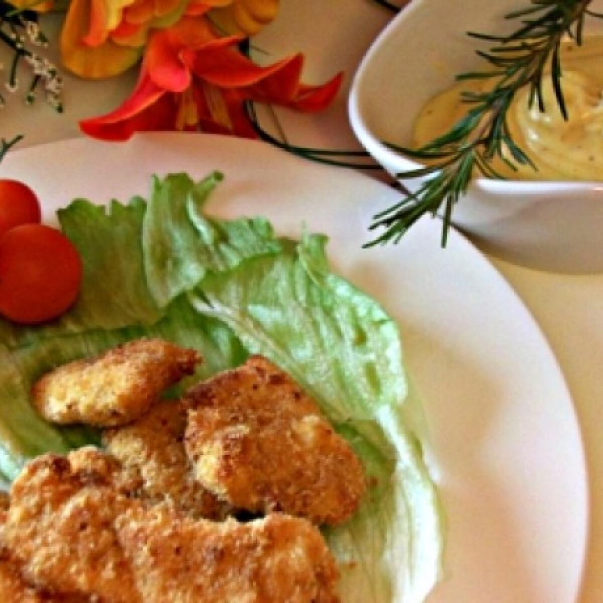 Ezen a képen: Csirkefalatok parmezán sajt-mártással